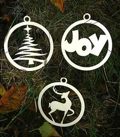 Circular Laser Cut Christmas Decorations (butterfly and angel?)