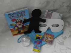 Our Wedding Fun Bag for Boys packed with a snowstorm, mosaic coaster kit, scratch art figure, maze, pirate sticker activity book and crayons all in a lovely bag to keep.