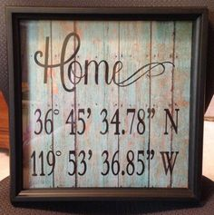Framed Home sign with GPS coordinates. Used cricut for fonts onto weathered boards paper.