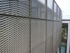 Closer detail of WPL's Expanded Mesh Expanded Metal, Stone Facade, Trafford, Town Hall, Showroom, Closer, Skyscraper, Multi Story Building, Mesh