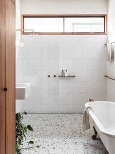 Bathroom Renos, Laundry In Bathroom, Remodel Bathroom, Bathroom Renovations, White Bathroom Wall Tiles, Washroom Tiles, Neutral Bathroom Tile, Bathroom Store, 1950s Bathroom