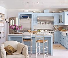 Blue is a very unusual colour for a kitchen, yet lovely.