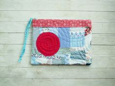 Big pink spot on sky blue patchwork quilted zipper by poppyshome, $22.00