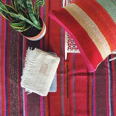 An outtake from a recent Cambie shoot! Prop styling and a wrinkly rug ☺️ #Cambie #CambieDesign #Peruvian #Blanket #Rug #Colorful #Stripes