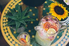 Festival Style Patio Makeover | Details: Moroccan table, fresh fruity drinks, and a perfect yellow sunflower.