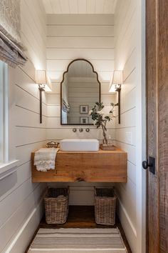 Farmhouse bathroom with shiplap walls, floating wood slab vanity and Roman shades