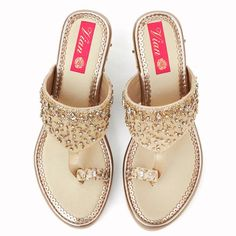 """All made to order products take 10-12 days to produce and dispatch so the shipping time frames differ from regular products. The """"have to have in your closet"""". On an ivory white base, this pair has a mix of embellishments and rhinestones, in a mix of gold and silver. The elements are closely stitched on one side and gr Gold Wedge Shoes, Gold Wedges, Bag Icon, Dupion Silk, Jack Rogers, Palm Beach Sandals, Shoe Closet, Ivory White, Footwear"""