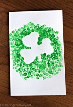 "This shamrock craft took only moments to make and my daughter had so much fun making it.  She ""painted"" on the front of a card that we'll be mailing to grandparents for St. Patrick's Day. We used a..."