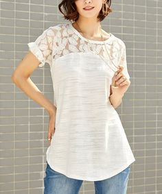 An intricate lace yoke frames your face in this sweet short-sleeved tee. Soft cotton-blend fabric makes it a breathable choice, ideal for sunny days. Shipping note: This item is made to order. Allow extra time for your special find to ship.