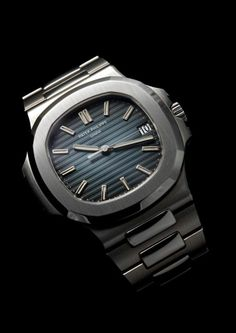 Patek Philippe 5711/1A-010 Nautilus in Stainless Steel.  The 5711 has a case diameter of 43mm, one millimeter larger than its 1976 predecessor. The three-part case has a screwed back with a sapphire-crystal caseback and a screw-down crown; water resistant to 120 meters. The movement is the self-winding Patek Philippe Calibre 324 SC, powered by 21K gold central rotor. The dial displays the hours, minutes, sweep seconds, and the date in an aperture at 3 o'clock.  A timeless classic,