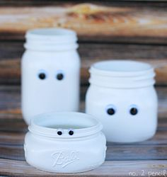 These mason jar ghosts are so fabulous on so many levels …  so, so many levels!  What a fun kid's craft idea for Halloween …  Or how cute would these mason jar ghosts look at a Halloween party? Maybe even as a party favor for the kids …  filled to the …