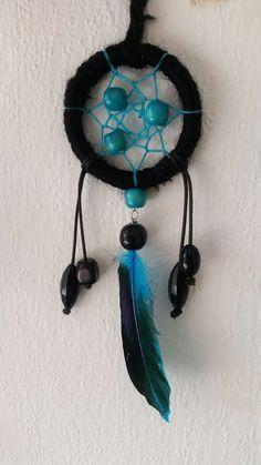 Mooie exclusieve kleine dromenvanger. Kleur zwart met blauw . Doorsnede 7cm.