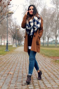 warm in winter: brown coat, blue sweater, white shirt and brown booties and blue plaid scarf. Little black coconut