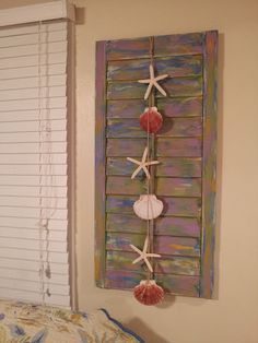 I made these for my Delray Beach, Florida Vacation Cottage. VRBO property #174171.  Old shutters sanded, painted, and adorned with a string of shells.  One hung on each side of the window above the bed.  No need for a headboard.