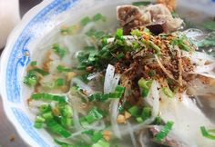 Thick noodle soup (Phu Quoc, Vietnam) is famous for its chewy fish cake which is totally made from mackerel and well seasoned. Moreover, the broth for the dish is made from simmered pig's bones and minced pork.   Where to eat: Ms. Phụng restaurant at Quarter 2, near DinhCau market, Duong Dong town