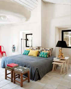 a gorgeous country home near lisbon, portugal     Love the colorful pillows on the bed