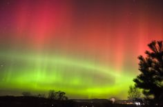 A view of the Northern Lights as seen from Crooktree in Aberdeenshire, Scotland, Thursday. The light show occurs when highly charged electro...
