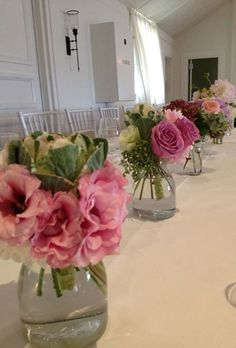 Mason jars would look real cute!  centrepiece (with white flowers)