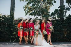 Bridesmaids in red lace dresses
