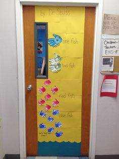 """Dr. Seuss """"One Fish, Two Fish, Red Fish, Blue Fish"""" door decoration using children's & teachers' hands for the fish."""