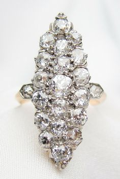 Victorian diamond ring - showcasing over 2 carats of old European-cut diamonds! isadoras.com