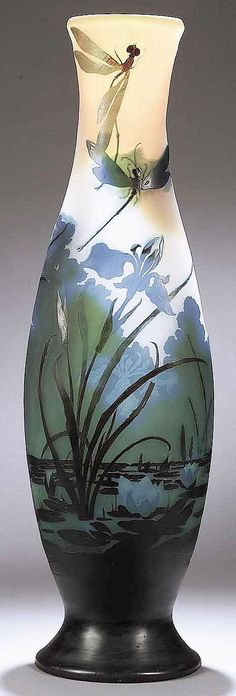 "✨ Emile Gallé - Iris & Dragonflies Cameo Glass Vase, c. 1885-1900 ///  Flattened elongated baluster form, amber yellow shading to a pale gray frosted ground, overlaid in azure, olive green, and emerald, depicting two large dragonflies hovering above a pond scene with blossoming irises and water lilies, signed ""Galle"" in cameo, height 33 3/8 in. Note: By family repute, this vase was exhibited at the 1889 Paris Exposition Universelle."