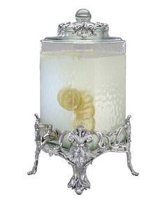 Hold court with the regal elegance of Fleur de Lis serveware and serving dishes. Lavish detail featuring the iconic French lily evoke another era, gleaming spectacularly on this magnificent beverage s