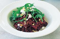 We bet this beetroot risotto, served with crumbled goat's cheese and crunchy walnuts, won't just be the choice of vegetarians.