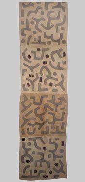A fragment of a Kuba rafia applique skirt Zaire late 20th century. Measurements:60 cm's x 220cm's