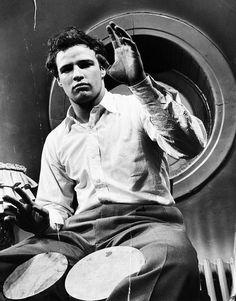 Marlon Brando plays bongos.