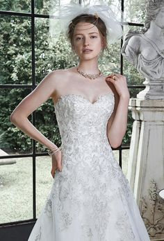 Brides: Maggie Sottero. More details from Maggie SotteroTulle A-line dress, adorned with metallic embroidered lace. Finished with corset closure. Detachable lace cap-sleeves are offered separately.