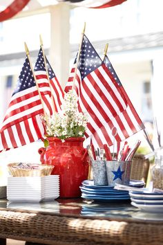 Add a flag or five to your centerpiece. #potterybarn