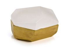 Andrea Walsh's faceted boxes are created from a fine bone china base and topped with a frosted glass lid