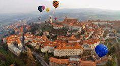 Hot air balloons flying over Mondovì