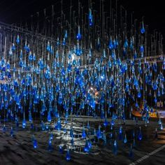 Luz Interruptus fills 3,000 condoms with water to create giant raindrops