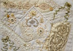 "Made for the AAQI, this is quilt #13753. It is a collection of vintage crochet, embroidery and handkerchiefs as well as new machine embroidery and vintage buttons. It is covered with hand ribbon and bead work. It measures approx. 8.75""x11.75"". Photography by Marie Dort. This quilt raised $145.00 for Alzheimer's Research!"
