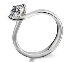 Gorgeous round brilliant cut swirl diamond engagement ring by www.diamondsandrings.co.uk