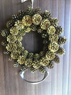 Golden pinecone wreath, door or wall . #pinecone #wreath #christmas #christmascrafts