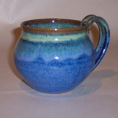 Love this shape for a mug. I would do a handle with a little curl at the end