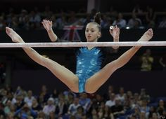 Romania's gymnast Larisa Andreea Iordache performs on the uneven bars during the artistic gymnastics women's individual all-around competition at the 2012 Summer Olympics, Thursday, Aug. 2, 2012, in London.