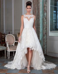 Justin Alexander signature wedding dresses style 9818 You will be sure to make a fierce entrance with this high-low ball gown featuring corded embroidered lace on a nude illusion neckline, with soft handkerchief underlay and an illusion back. Also available in full length as style 9818F/9823.