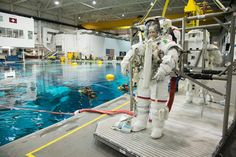 European Space Agency astronaut Samantha Cristoforetti wears a NASA spacesuit ahead of spacewalk training inside the Neutral Buoyancy Laboratory, a giant training pool near the Johnson Space Center in Houston.