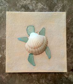 Turtle canvas made by Kristina Gavigan- painted canvas with real sand added then turtle made out of glittered shell and sea glass pieces #beach_crafts_canvas