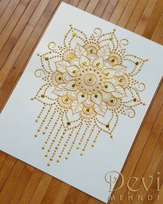 A floral mandala design decorated with dot chains. The materials I used to do this were sequins and fabric paint.