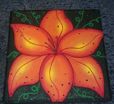 stepping stones alond walkway. hawaiian flower... painted stepping stone