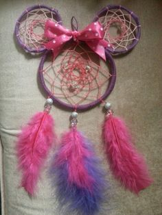 Purple and pink minnie mouse dream catcher I made! :) You can get one just like this at  http://www.etsy.com/shop/BmoreYOUnique . We do custom orders too in any colors you like!