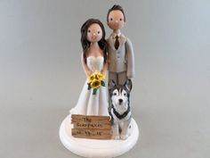 This listing is for a bride and groom wedding cake topper, which starts at $135 and made to fit your description (attire, hair and eye color, bouquet