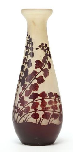 """GALLÉ OVERLAY GLASS CABINET VASE White glass with brown overlay in a foliate motif, circa 1900 Marks: Galle (cameo) 8-1/4"""" high (21 cm) (hva)"""