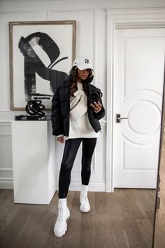 fashion blogger wearing chunky white combat boots from forever 21. this affordable puffer jacket is the quintessential outerwear for those off-duty, on-the-go outfits. You can brave even the coldest temps in this one. It feels way more expensive and will keep you warm through winter. #pufferjacket #outfits #style Combat Boot Outfits, Black Combat Boots, Capsule Wardrobe Essentials, Fall Capsule Wardrobe, Fendi Dress, Christian Louboutin So Kate, Faux Leather Leggings, Chilly Weather