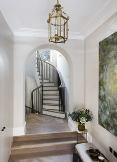 Nathalie Priem Photography  Sweeping staircase in Notting Hill home. designed by Echlin.